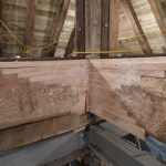 The carpenter repaired the cross beams with laminated oak boards